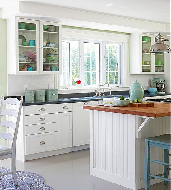 Cottage Kitchen Designs Photo Gallery: This Cottage-style Kitchen Maintains A Polished Look With