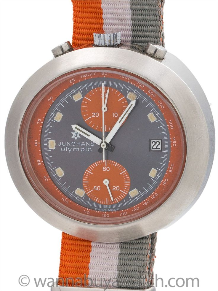 Junghans Bull's Head Chronograph Munich Olympics circa 1972 - Junghans Stainless Steel Chronograph circa 1972. Distinctive manual wind Valjoux 7734 with day and date function produced for the Munich Olympics game. Featuring large egg shaped case 45 X 42mm with bull's head style chronograph pushers located at top of case. Gorgeous and mint condition original colorful gray dial with large orange registers and silver applied indexes with white details. Dial signed Junghans Olympic. Junghans had…