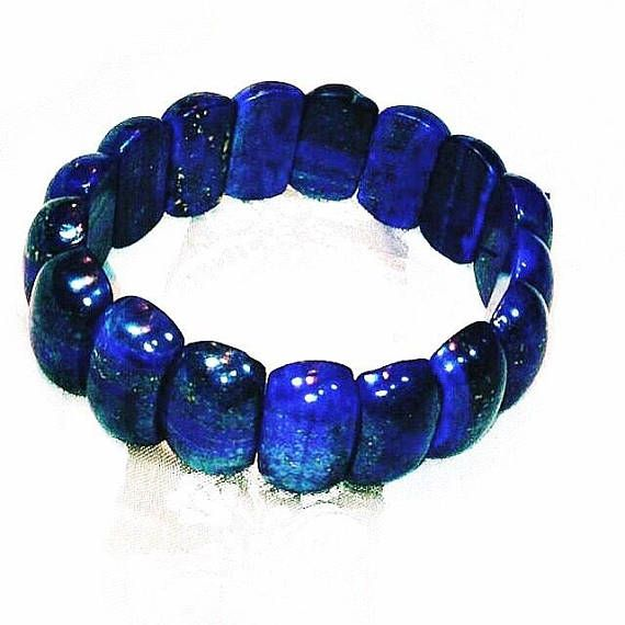 Lapis Lazuli Bracelet, Stretch Bracelet, Handmade By NorthCoastCottage Jewelry Design & Vintage Treasures. Beautiful, trendy and, better yet, flecked with yellow gold. This handmade lapis bracelet is made with power stretch bracelet cord, one size fits all. About lapis lazuli. Lapis