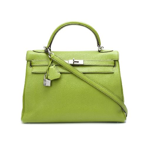 Anise green calf leather 'Retourne Kelly 32' tote from Hermès Vintage featuring a trapeze body, a pebbled leather texture, foldover top with twist-lock closure, a hanging key fob, a padlock fastening detail, silver-tone hardware, an internal zipped pocket and purse feet. This item comes with a dust bag. Please note that vintage items are not new and therefore might have minor imperfections. Size: OS. Color: Green. Gender: Female. Material: Calf Leather.