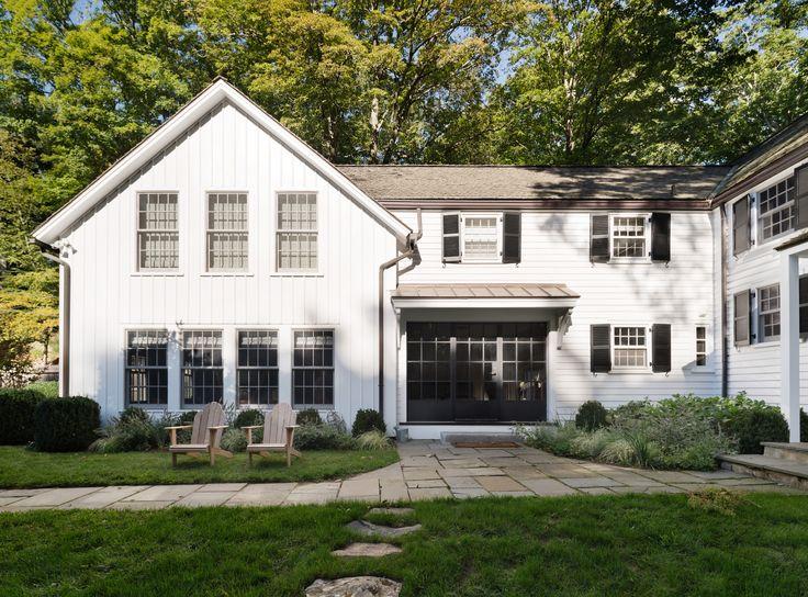 Rafe Churchill renovated Bedford NY farmhouse - exterior-modern-farmhouse-renovation-white-black-shutters