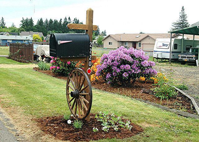 Wagon wheel and plantings/ Huh thats an idea!