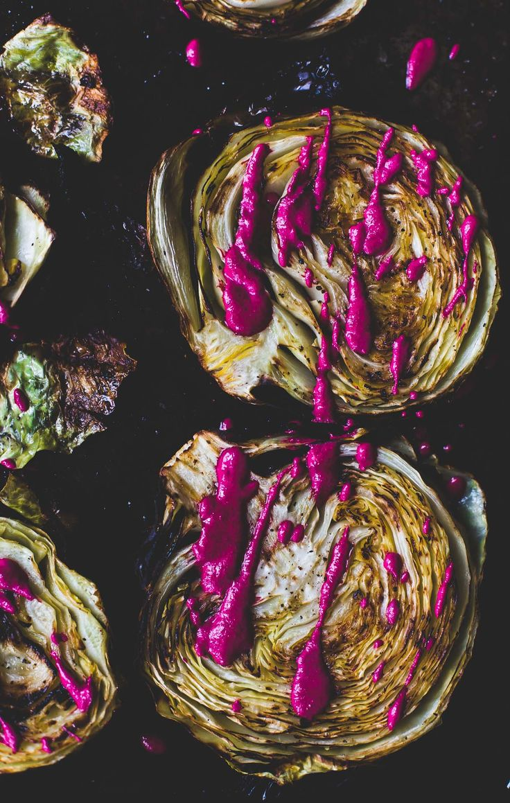 Crispy, crunchy edges adorn these roasted cabbage steaks, drizzled with a garlicky beet sauce. Vegetarian and gluten-free recipe.