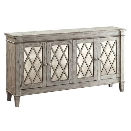 Perfect for stowing glassware in your dining room or displaying a bouquet of fresh blooms in the den, this 4-door mirrored sideboard showcases latticed panel...