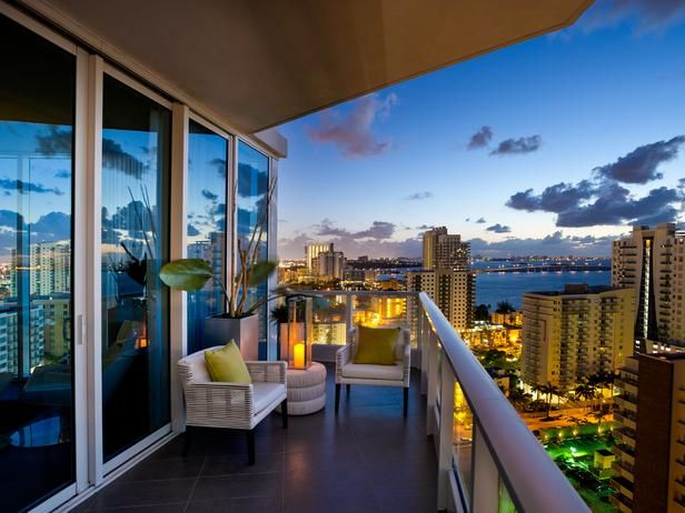 Extending from the living room, an 8-foot terrace with glass railing is generous enough to accommodate a small party of guests.Glasses Railings, Dreams, Luxury Condo, Urban Oasis, The View, Miami, Living Room, Small Parties, South Beach