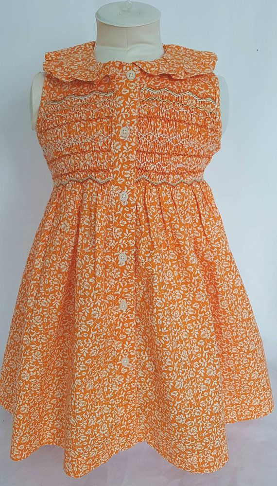 Beautiful Orange floral hand smocked dress  size 1 2 and 3