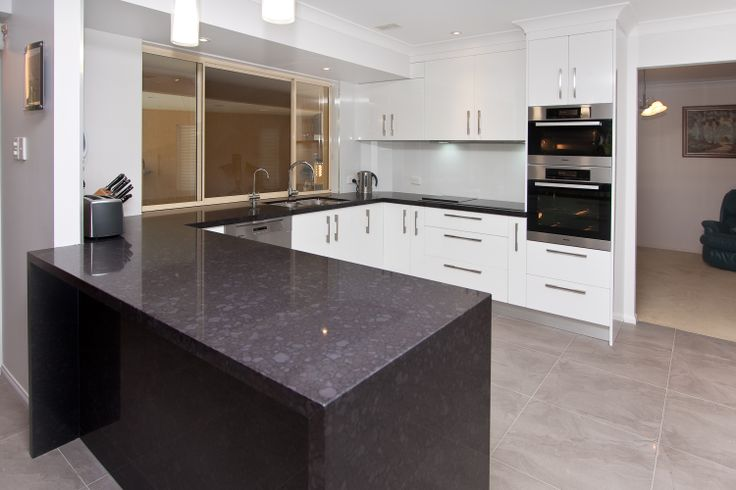 Add a new touch to the classic black and white combination with stone. www.onecallkitchens.com.au