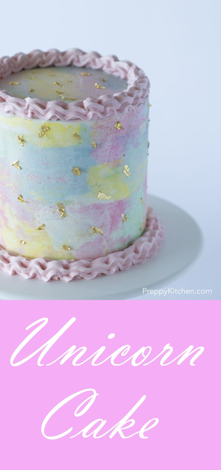 A unicorn cake can look like an actual unicorn or can be more conceptually unicornish. This cake is of the latter. I've made a watercolor cake with soft pink edging (824 tip) and a smattering of edible gold.