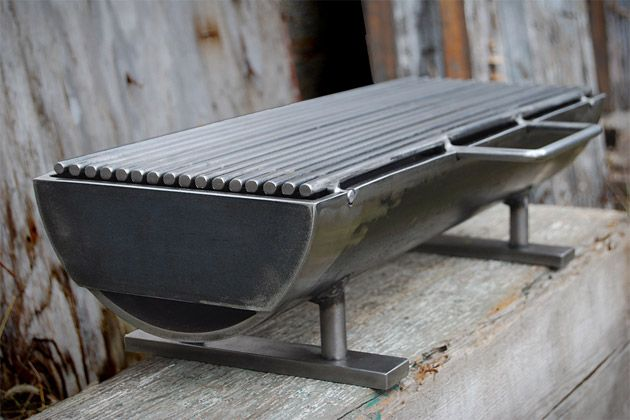 """The Hibachinator. Made from welded steel, it weighs in at a hefty 50 lbs., and offers a large, table-friendly 8"""" x 24"""" removable grilling surface, grilling bars that are close together to keep small morsels from falling through, and an optional stainless steel grilling top."""