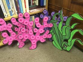 Free standing coral & seaweed painted on foam board, with sliced pool noodles for 3-D effect