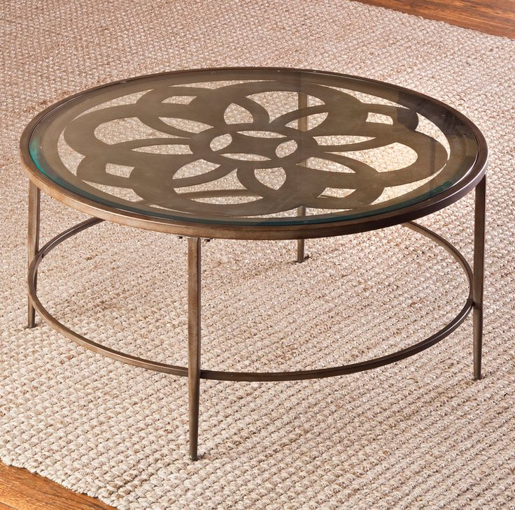beautiful metal round glass top coffee table has tapered legs bold design beveled glass