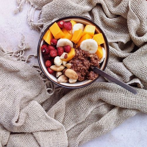 Wake up to a bowl of fresh fruit, granola, and milk.