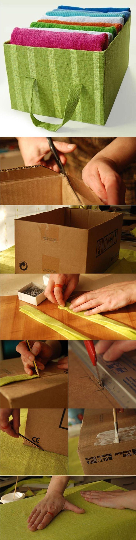 Caixas de papelão foram encapadas com tecido colorido e transformadas em organizadores. / Crédito: Pinterest.