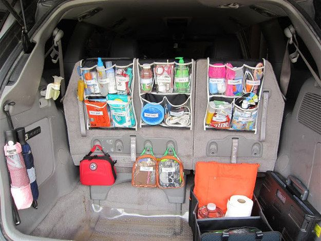 Shoe organizers can transform your trunk into a command center. | 17 Super-Easy Ways To Get Your Car Organized AF