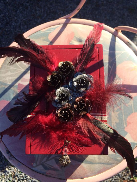 Red cigar box purse with roses and feathers