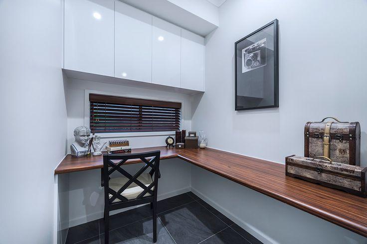 #Study #Nook #ideas from Ausbuild's #Allendale display #home. www.ausbuild.com.au. This #nook is complete with a #signature #black #chair and #vintage brief case #pieces.