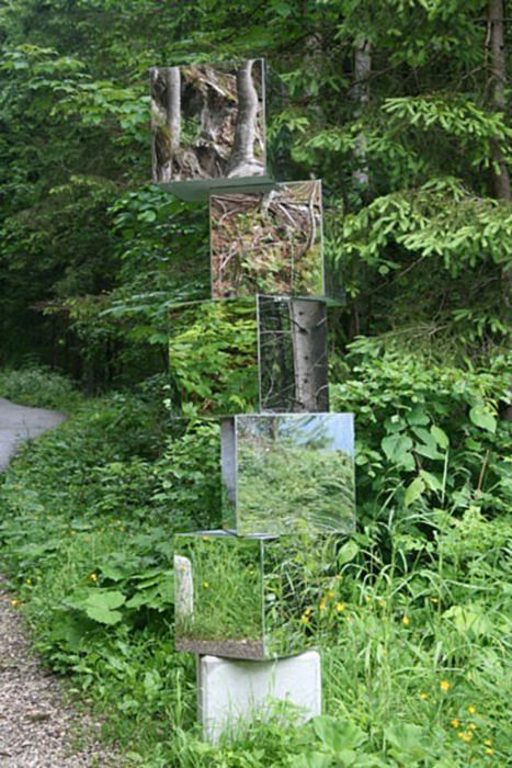 What a great idea. Mirror blocks in the garden