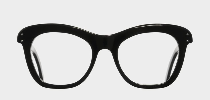 A soft, cat-eye optical frame featuring a swooping browline and domed pins.
