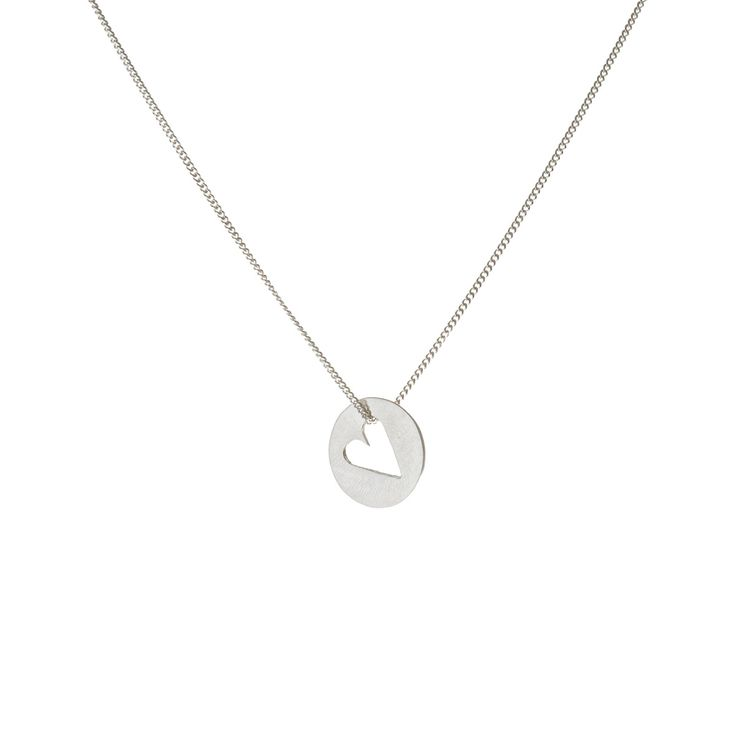 A sterling silver disc, with a heart shape cut out, on a silver chain.