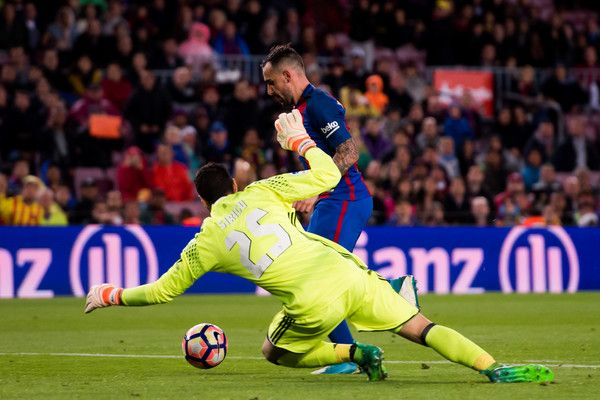 Paco Alcacer of FC Barcelona dribbles Salvatore Sirigu of CA Osasuna to score his team's seventh goal during the La Liga match between FC Barcelona and CA Osasuna at Camp Nou stadium on April 26, 2017 in Barcelona, Catalonia.