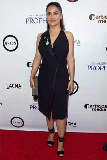 Salma Hayek in red and black Gucci sandals.