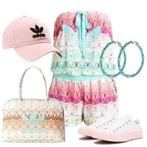 Tuta jumpsuit multicolor Adidas, senza maniche e con elastico in vita, Converse bianche e rosa, shopping bag Adidas multicolor e cappellino con visiera rosa, sempre Adidas. Infine orecchini a cerchio, turchese.