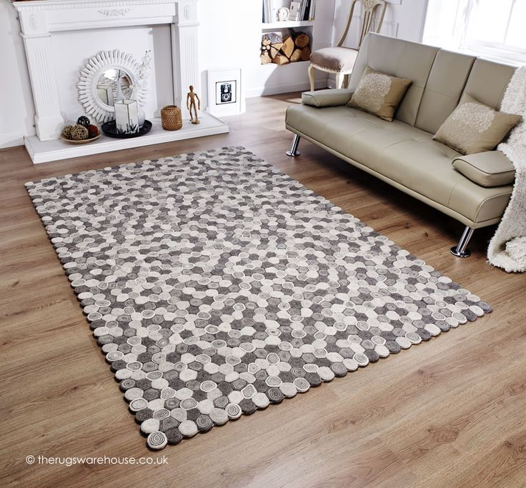 Sushi Natural Rug, an unusual handmade 100% felted wool rug in cream & grey