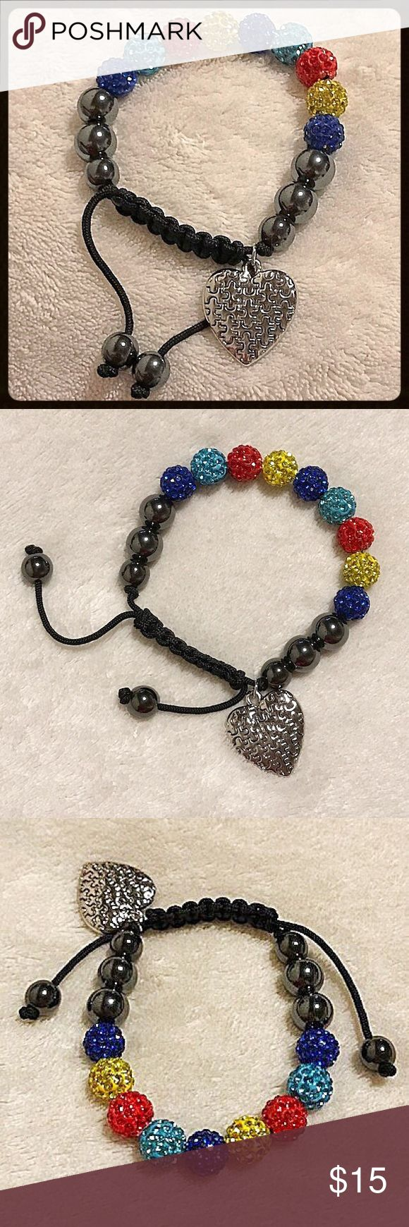 Autism Awareness Bracelet Adjustable Autism Awareness bracelet with dangle puzzle piece heart pendant, 9 colorful 10mm crystal beads, 4 10mm magnetic Hematite balls and 4 8mm magnetic Hematite balls. The drawstring allows plenty of room for any size wrist. Jewelry Bracelets