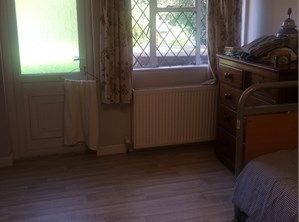 Double room with ensuite - Chertsey, Surrey. Ground floor room looking out onto garden, ensuite wet room, with toilet and sink. Walking distance to town, bus stop, train.   Prefer younger males to fit in with rest of household, we have 4 cats!
