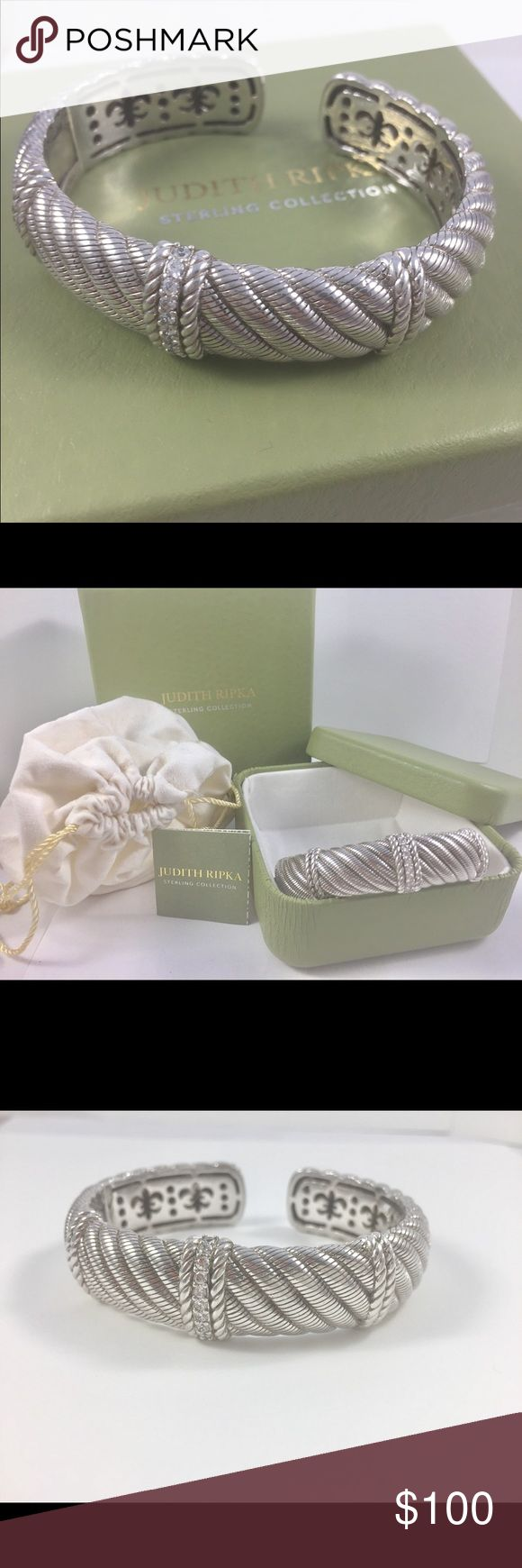 """NWT Judith Ripka SS .925 fashion bracelet with czs NWT includes inner & outer boxes, dust bag, fold-out brochure. .925 sterling silver bracelet. Very heavy, 78 grams, 3/4 inches wide with a hinge. An employee found this misplaced while cleaning my stockroom. Still new and in the box. The bracelet is 8 1/2  from tip to tip. The inside measurements are 2"""" in width and 2.5"""" in length which is a size large. I'm offering this one at a great low price; however, the price is firm. This has cubic…"""