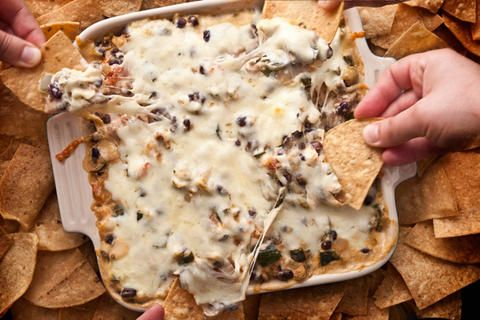 Spicy Chicken & Chile Taco Dip --- chicken, black beans, tomatoes, cheeses, and hot peppers to spice it up
