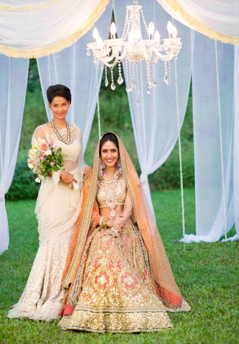 Bride & bridesmaid styled by Nisha Kundnani of Bridélan which is a personal wedding shopper & styling services. Visit www.bridelan.com for more. The bride in a gorgeous Sabyasachi gold and peach lehenga