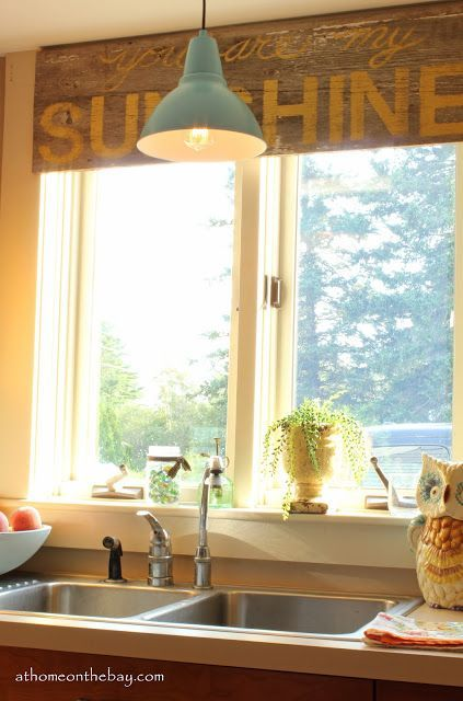 Cottage tour filled with great ideas like this DIY barn light and Sunshine sign