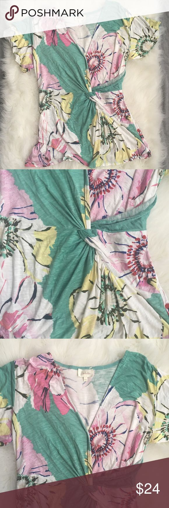 Anthropologie Deletta floral wrap top Like new, no stains or flaws. This floral top has a little flair with its knotted and cinched wrap front that carries over to the back, it is mainly green with pink, white, red and yellow floral accents Anthropologie Tops Tees - Short Sleeve