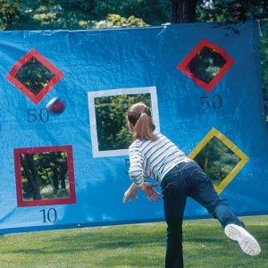 DIY Throwing Tarp. Fun game!!! Take a tarp, cut some squares, tape the cuts, use a marker to designate points, hang with ropes & play ball.