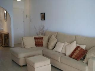A corner couch would be a good option for a small apartment as it only takes up a corner. Leaving other space available