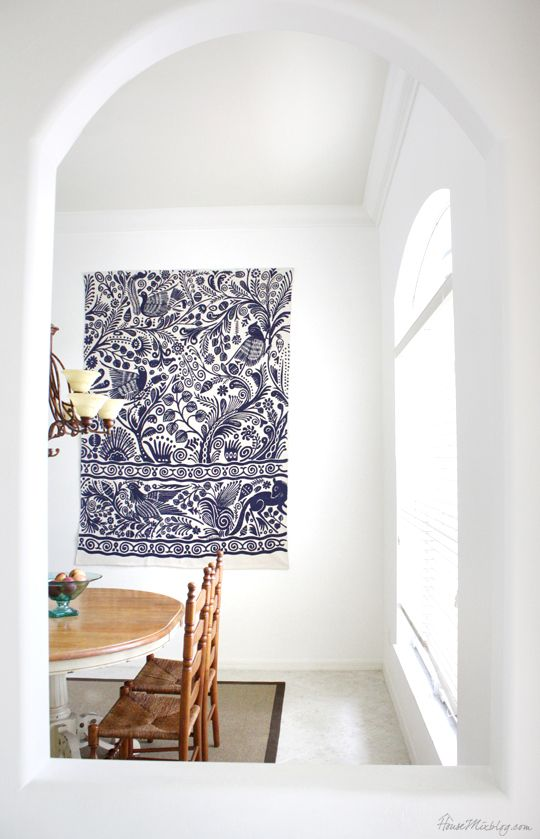 How to hang a rug on the wall as art. Good idea for a big blank wall.