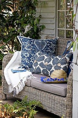 gray siding, wicker, cushions with the slate blue and white accents