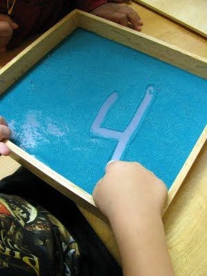 Writing in the sand--a great sensory way for children to link sounds and letters together in a fun and creative way rather than just writing with pencils and paper. They will remember it better as its fun!