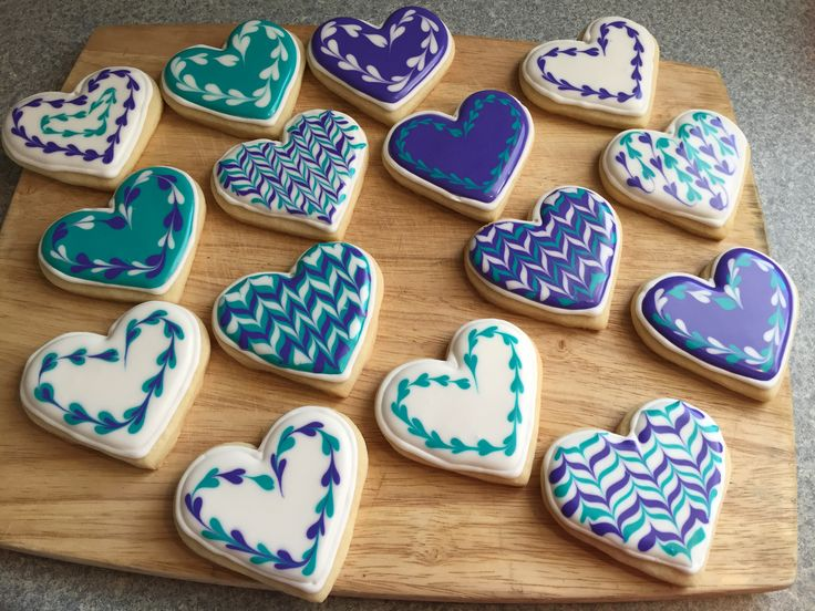 Wet on wet royal icing technique on sugar cookies. Perfect Valentine's cookies. By Debra's Adoption Bake Shop.