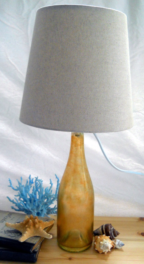 rustic sunset lamp upcycled wine bottle hand painted a light orange over layed with an orange gold
