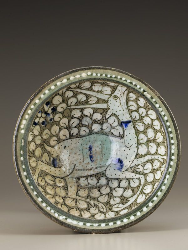 Deep bowl  late 13th-early 14th    Il-Khanid period     Stone-paste painted under clear glaze  H: 14.8 W: 27.0 cm   Iran