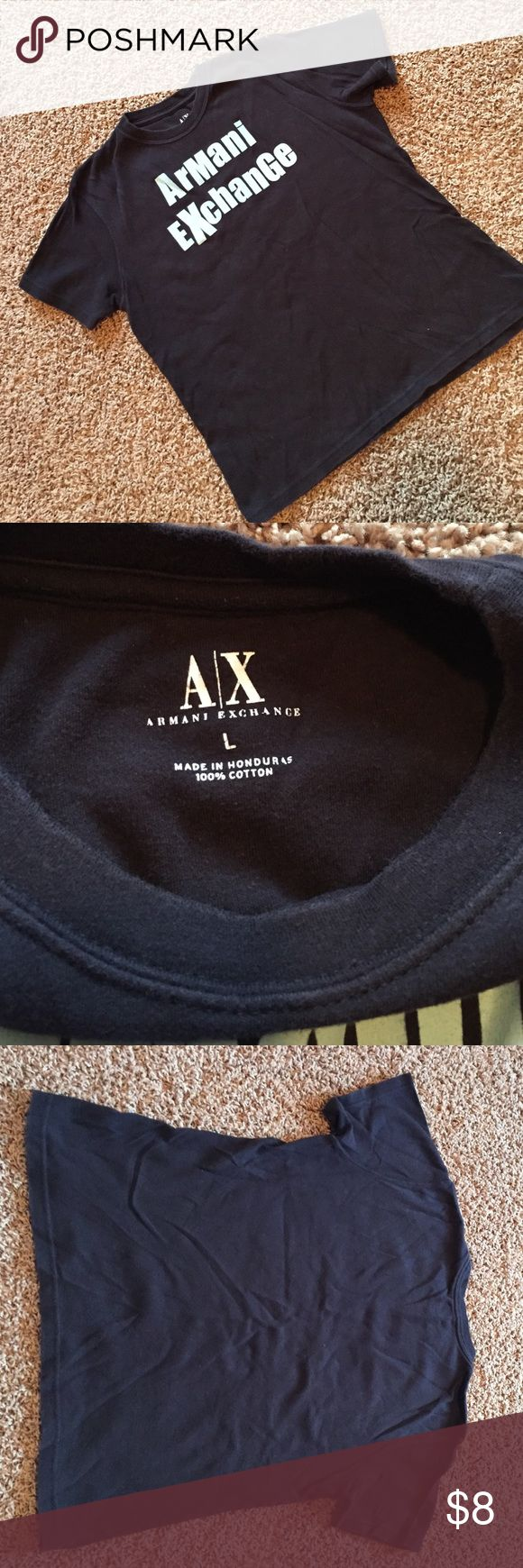 """Armani Exchange fun vintage baby tee black This one is a throwback! Do you miss the baby tee days? This cute 100% cotton tee from Armani exchange is from the era of the baby tee. It's marked as a size large but definitely runs small in typical baby tee style. 22"""" from shoulder to hem, bust 18.5"""" across. Fun! A/X Armani Exchange Tops Tees - Short Sleeve"""