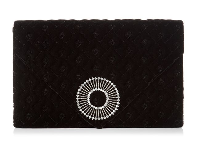 A stunning Wallace Black envelope clutch bag from Wilbur & Gussie. This bag has been beautifully designed with a black velvet fabric and has a jewel encrusted brooch. Bag has an optional chain, inner pocket, inner divide and magnetic fastening. View more bags from our Wilbur & Gussie Collection at: http://www.baroqueboutique.co.uk/wedding-shoes-and-accessories/
