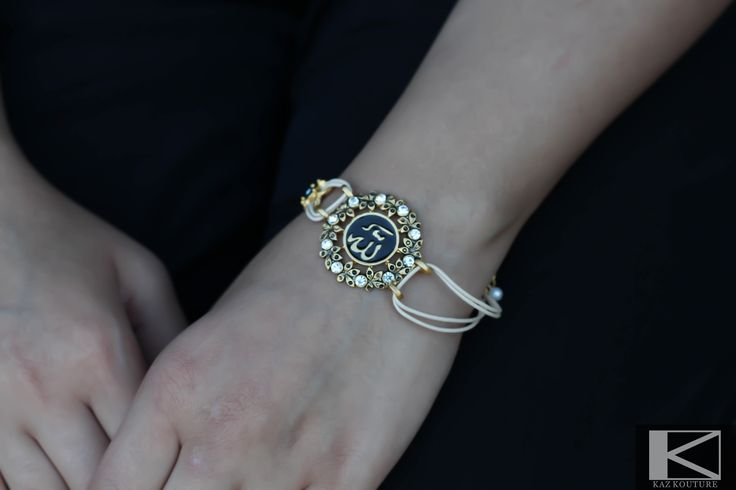 "KAZ KOUTURE: White Strap Allah ""God"" Crystal Bracelet #kazkouture #fashion #bracelet #goldplated #jewelry #accessories #armcandy #princess #fashionista #turkish #arabiccalligraphy #muslimfashion #abaya #hijabi #hijab #arabfashion #scarf #muslim"