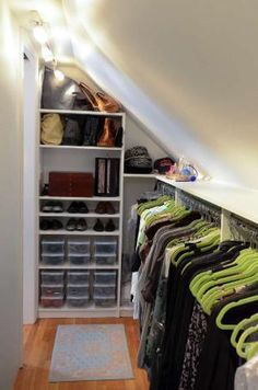 Closet designer Jamie Bevec transformed a crawl space off her master bedroom into a long, well-organized closet that now accommodates her wardrobe, shown, as well as her husband's.