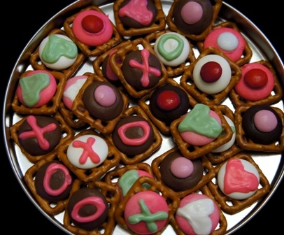 s0 love this idea! Small Square pretsel topped w/ hershey kiss or caramel rolo then topped w/M&M or Reeses pieces.
