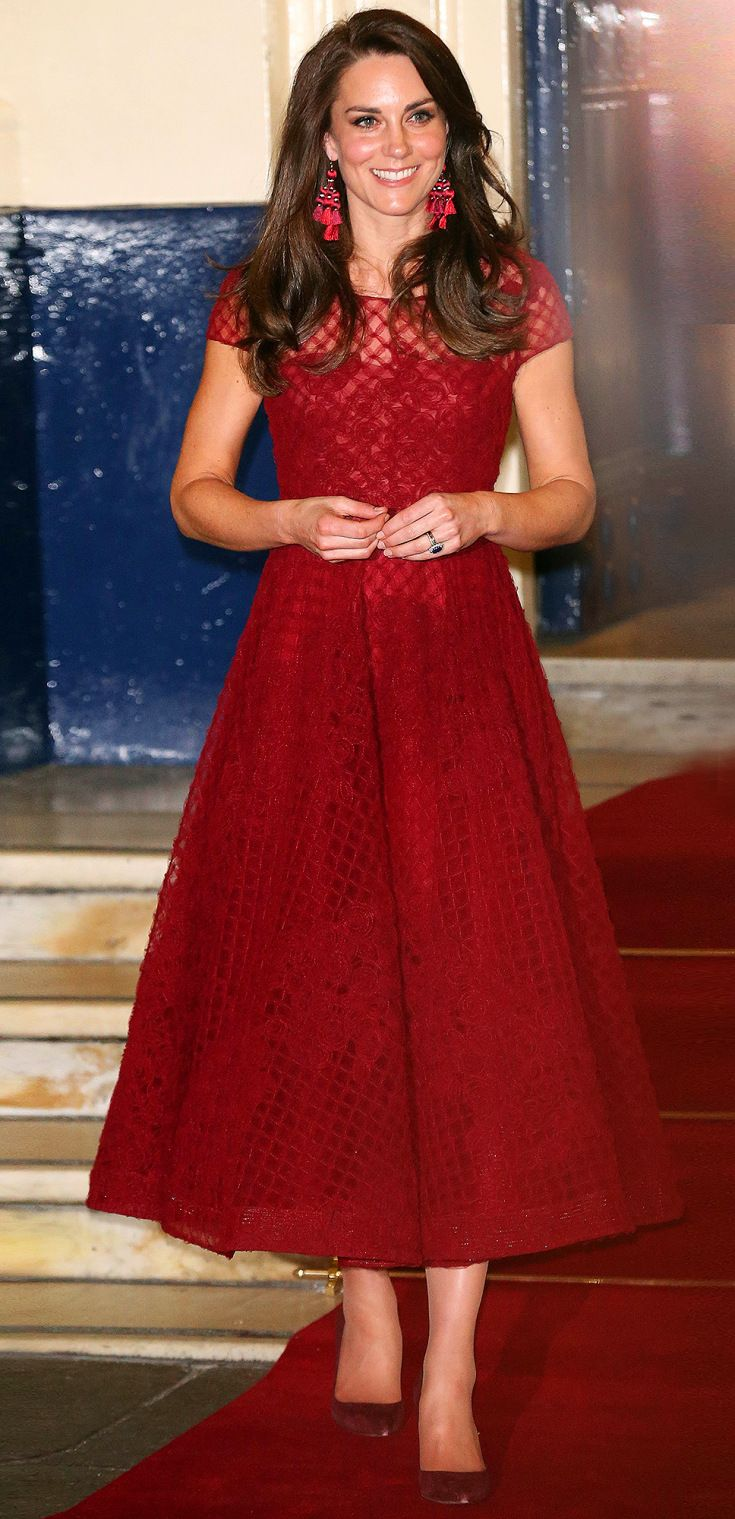 PRINCESS KATE in a crimson Marchesa Notte midi dress, $98 Kate Spade New York earrings and matching pumps at the opening of the musical 42nd Street at the Theatre Royal in London.