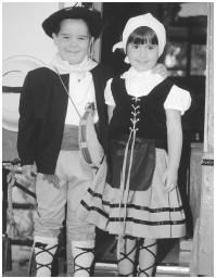 These young Basque American children are dressed traditionally to perform at a town celebration.