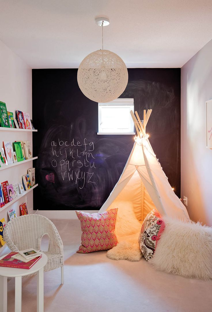 This whimsical #playroom is full of wonder thanks to a cozy #teepee and #Moooi Random light.